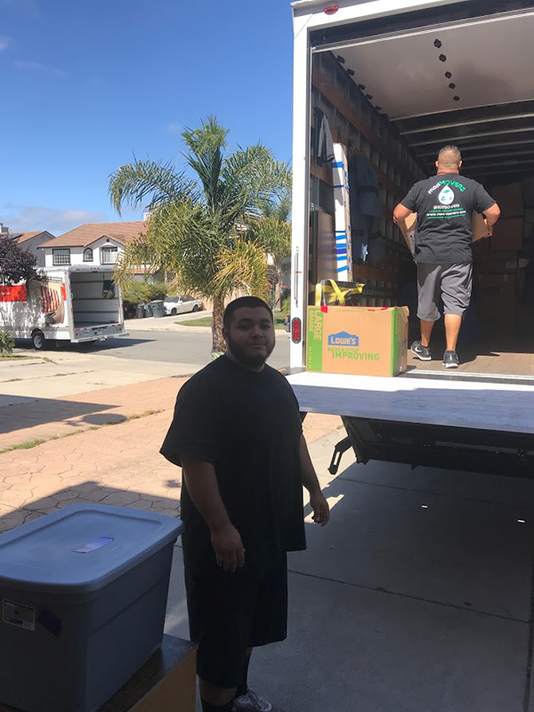 Movers Unloading Truck