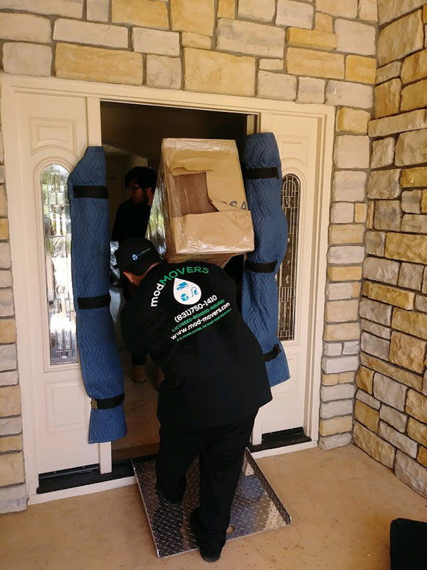 Movers Entering Home